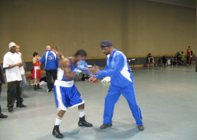 Head Coach Gary Johnson warming up his Athlete Custio Clayton at the 2012 Nationals